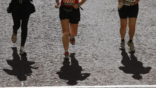 Athletes at the finish line of the 2009 Flora London Marathon (Sean Dempsey/PA)