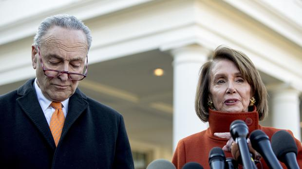 House Minority Leader Nancy Pelosi, accompanied by Senate Minority Leader Sen. Chuck Schumer speak after a meeting with President Donald Trump (Andrew Harnik/AP)