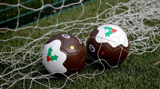 Special Christmas pudding footballs used in the annual Street Soccer Scotland festive football match in Edinburgh – (Jane Barlow/PA)