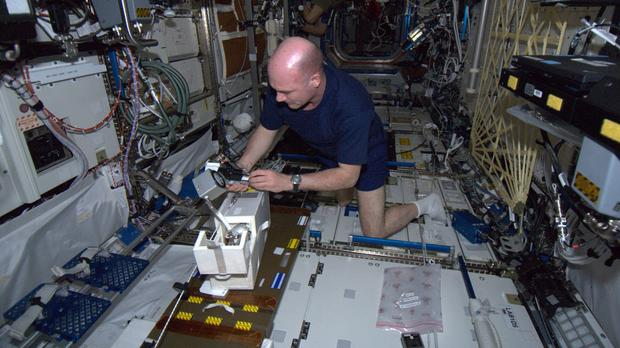 Kuipers first day at work during the PromISSe mission in 2012, calibrating the oxygen meters. (Credit: ESA/NASA)