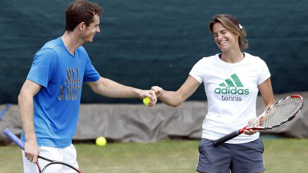 Andy Murray with Amelie Mauresmo (Jonathan Brady/PA)