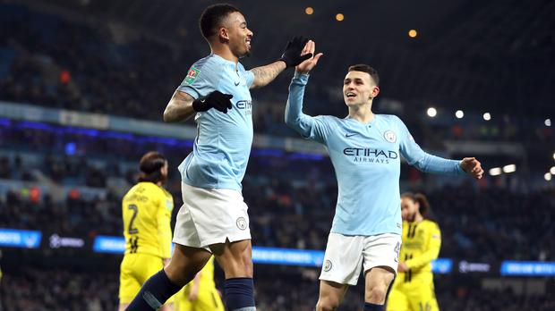 Manchester City's Gabriel Jesus (left) celebrates scoring his side's seventh goal of the game with Phil Foden during the Carabao Cup semi final (Martin Rickett/PA)