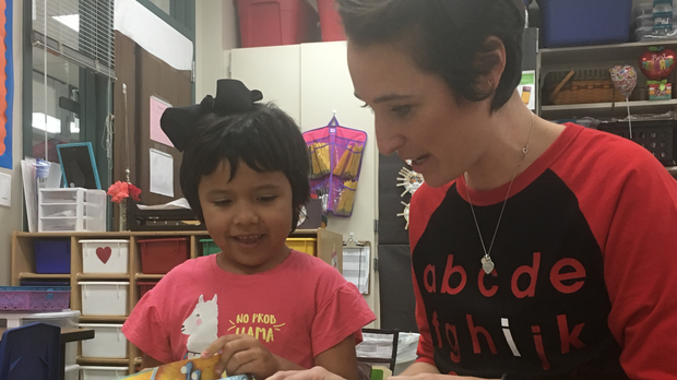 Teacher Shannon Grimm and her student Prisilla Perez with matching hair and ribbons (Willis ISD)