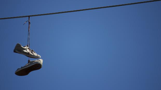Shoes hanging from a telephone wire (Credit: GaryVW/Getty)