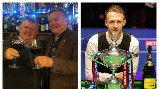 Happy punter Neil Morrice (left) celebrates with a friend after Judd Trump (right) became world champion (Neil Morrice/PA)