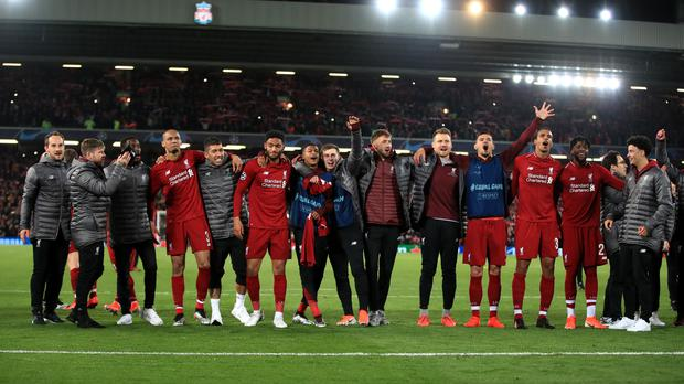 Liverpool players line up in front of their fans following the remarkable comeback against Barcelona (Peter Byrne/PA)