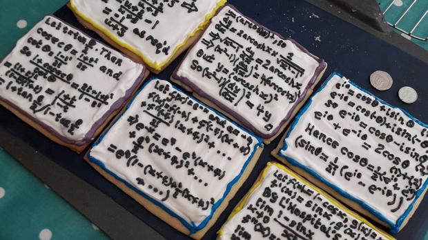 A photo of several biscuits with complicated maths piped on top (Ella Dickson)