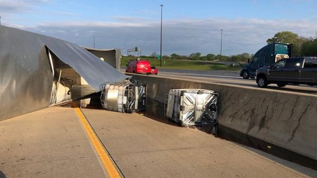 A vehicle which lost control on a road in America leaks honey and diesel fuel (Indiana State Police)