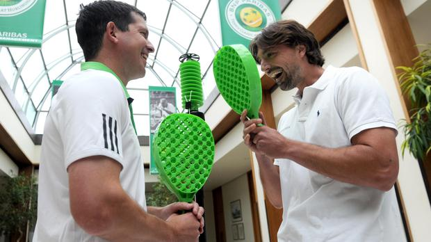 Tim Henman, left) and Goran Ivanisevic play swingball (Anthony Devlin/PA)