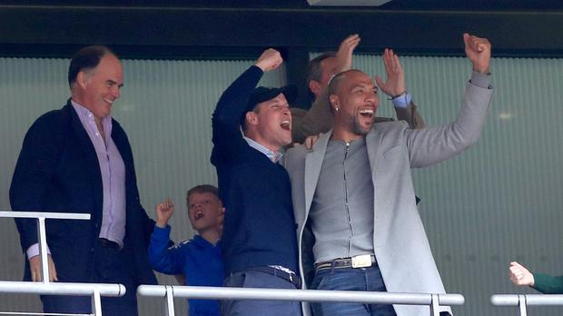 The Duke of Cambridge (left) celebrates in the stands with former footballer John Carew (right) after Aston Villa score in the Championship play-off final (Mike Egerton/PA)