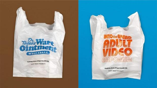 Two plastic bags designed to encourage shoppers to bring their own bags in Canada (East West Market/Facebook)
