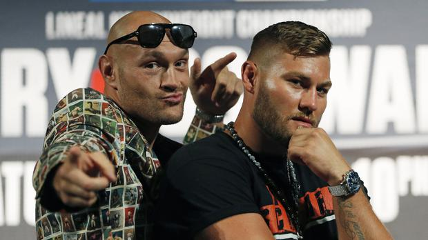 Tyson Fury, left, of England, and Tom Schwarz, of Germany, pose during a news conference for their upcoming fight (John Locher/AP)
