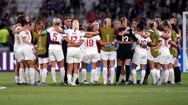 England head coach Phil Neville (centre left) leads a huddle after the final whistle during the FIFA Women's World Cup Semi Final match between England and the USA (John Walton/PA)