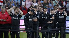 New Zealand's captain Kane Williamson, left, stands with his players as he waits for the trophy presentation after losing the Cricket World Cup final match between England and New Zealand at Lord's cricket ground (Matt Dunham/AP)