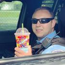 A police officer drinks a Slurpee (Park Forest Police Department)