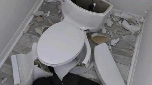 A toilet which exploded after being struck by lightning (A-1 Affordable Plumbing inc.)