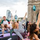 Reimagine Sunrise Flow yoga takes place on Tower Bridge, kicking off Car Free Day on Sunday September 22 (Mayor of London)