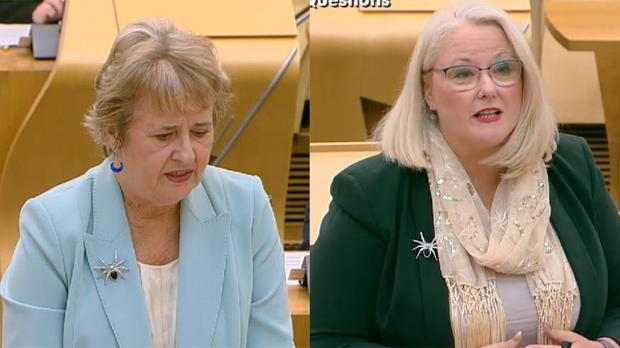 Two politicians at Holyrood sported matching spider brooches (Scottish Parliament TV)