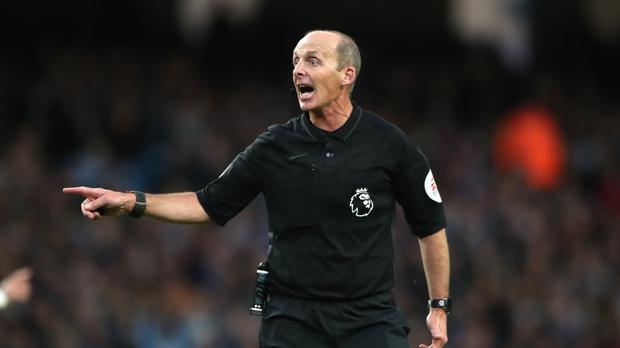 Mike Dean doing his day job (PA)