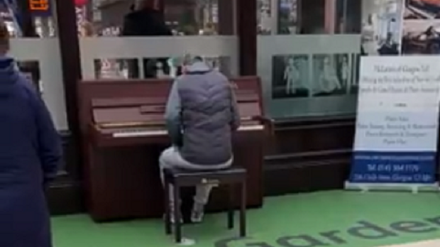 The musician plays the piano at Glasgow Central station (Twitter: @Heatherrnab/PA)