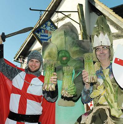 People dressed as, left to right, St George, Gus the asparagusman, Eve the asparagus fairy at the festival, which is held on St George's Day