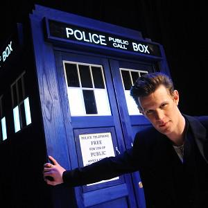 Doctor Who star Matt Smith stands next to a Tardis, one of which fan Tom Nichols has outside his house