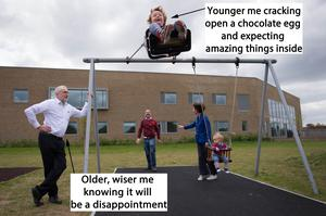 Corbyn watching a child on a swing