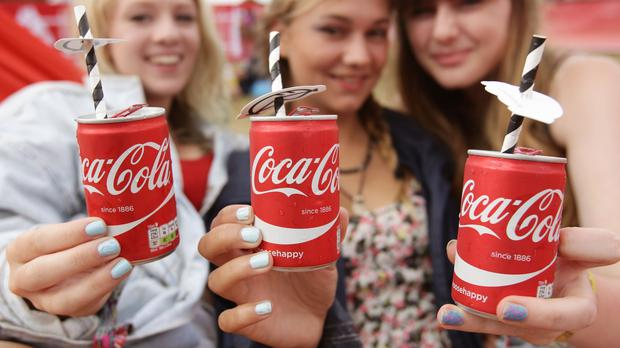 People drinking Coca-Cola at a festival (Yui Mok/PA)