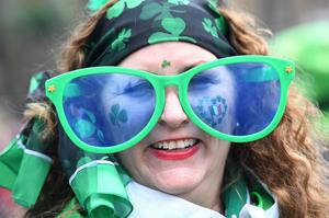 A woman enjoys the festivities at the Mayor of London's St Patrick's Day Parade and Festival in central London.