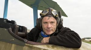Iron Maiden front-man Bruce Dickinson sitting in the cockpit of his own replica Fokker Dr1 aircraft which he will fly at Duxford Airshow (IWM Duxford/PA)