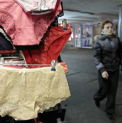 A woman passes a street side shop selling lace underwear in Kiev, Ukraine (AP)