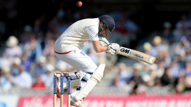 England's Joe Root shows how to avoid a bouncer.