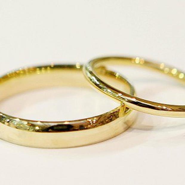 Couples who are married or in a civil partnership feel happier than co-habiting couples, statistics reveal