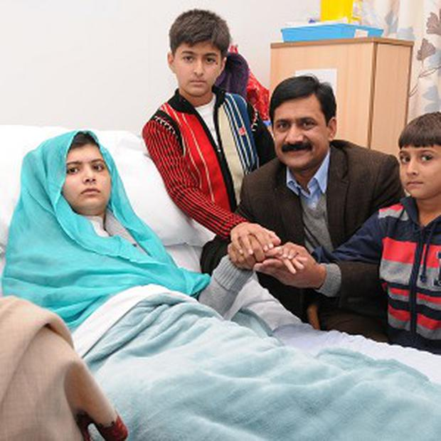 Undated handout photo issued by Queen Elizabeth Hospital Birmingham of Malala Yousufzai in her hospital bed with her father Ziauddin and her two younger brothers Atal Khan (far right) and Khushal Khan (centre). PRESS ASSOCIATION Photo. Issue date: Friday October 26, 2012. Her father thanked Dr Dave Rosser and the hospital staff for the treatment his daughter is receiving. See PA story POLITICS Schoolgirl. Photo credit should read: Queen Elizabeth Hospital Birmingham/PA Wire NOTE TO EDITORS: This handout photo may only be used in for editorial reporting purposes for the contemporaneous illustration of events, things or the people in the image or facts mentioned in the caption. Reuse of the picture may require further permission from the copyright holder.