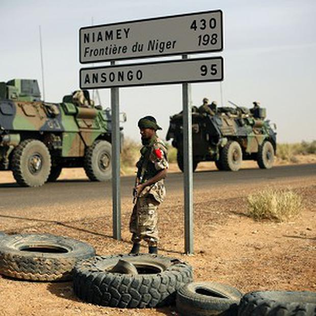 French armoured vehicles are seen heading towards the Niger border in northern Mali (AP)