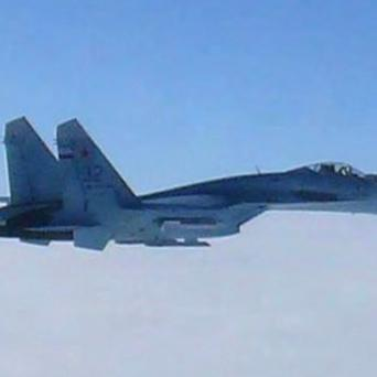 One of two Russian SU-27 fighter jets which Japan says violated its airspace over the sea off the island of Hokkaido (AP/Joint Staff Office of Defence Ministry of Japan)