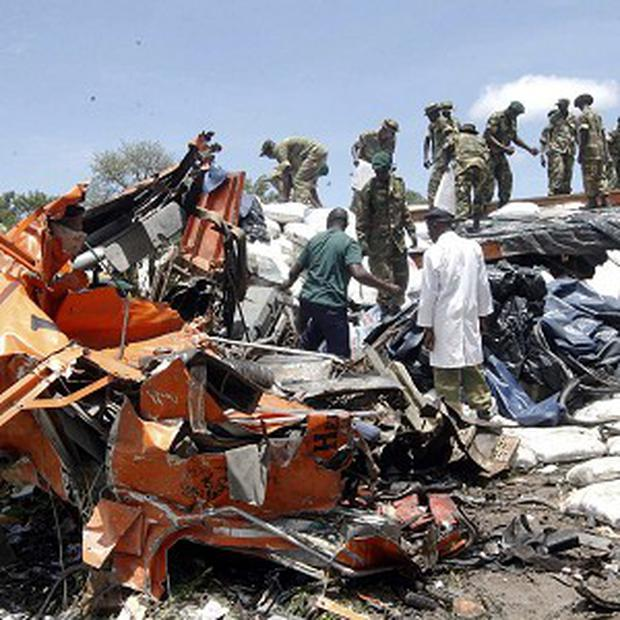 Military personnel search for bodies after a Zambia Postal Service bus collided with a truck (AP/Salim Dawood)