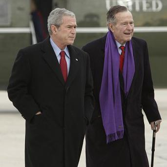 Former US Presidents George W. Bush, left, with his father, George H.W. Bush (AP)