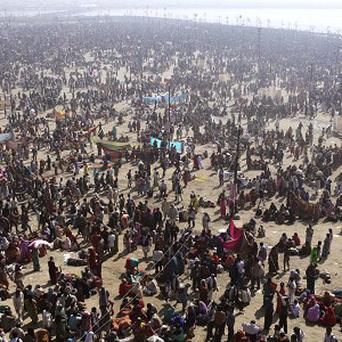 Millions of Hindu devotees arrive for a holy dip at Sangam, the confluence of Hindu holy rivers Ganges, Yamuna and the mythical Saraswati (AP)
