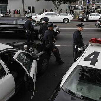 Extra police on patrol guarding against their renegade former colleague (AP)