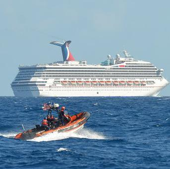A coastguard boat patrols near the cruise ship Carnival Triumph in the Gulf of Mexico (AP)