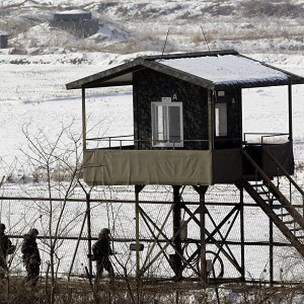 South Korean soldiers patrol along the barbed-wire fence near the border village of Panmunjom, which separates the two Koreas (AP)