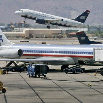 A merger deal between American Airlines and US Airways has been in the works since August (AP)