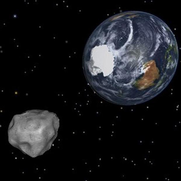 A simulation of asteroid 2012 DA14 approaching from the south as it passes through the Earth-moon system (AP/NASA/JPL-Caltech)