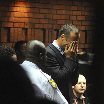 Oscar Pistorius weeps in court in Pretoria at his bail hearing in the murder case of his girlfriend Reeva Steenkamp (AP)