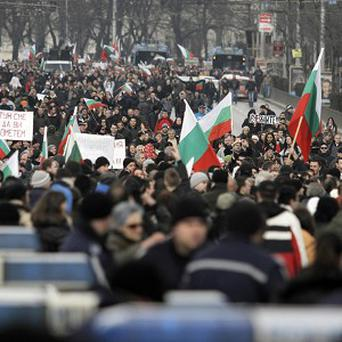 Protesters in Sofia block the traffic at main road juncture during a protest against higher electricity and heating bills in Bulgaria (AP)