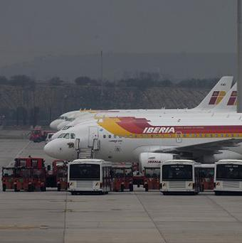 Iberia planes parked at Barajas international airport in Madrid (AP)