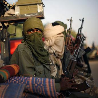 Tuareg Malian soldiers patrol the streets of Gao (AP)