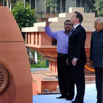 Prime Minister David Cameron visits the site of a notorious 1919 massacre in Amritsar, India (AP)