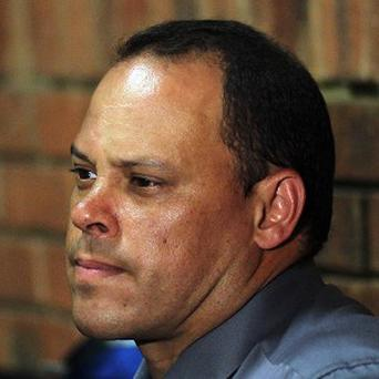 Investigating officer Hilton Botha sits in the witness box during the Oscar Pistorius bail hearing at the magistrates' court in Pretoria (AP)